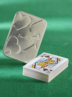 Le jeu de cartes dans sa boîte métal Pie